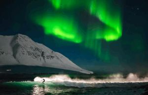 Surfer Under the Northern Lights