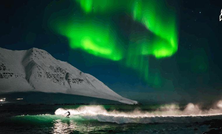 Surfer Under the Northern Lights