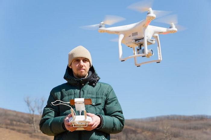 2_Man controlling drone
