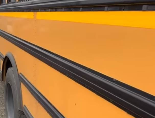 Three Black Lines on the Yellow School Buses