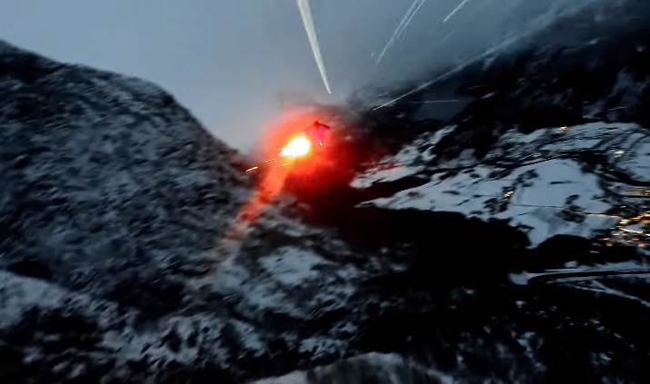 Insane Wingsuit Flight at Rainy Night With Flares