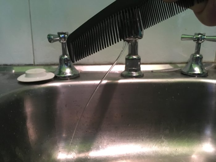 Become a Water Bender Science Experiment - charged nylon comb near tap water