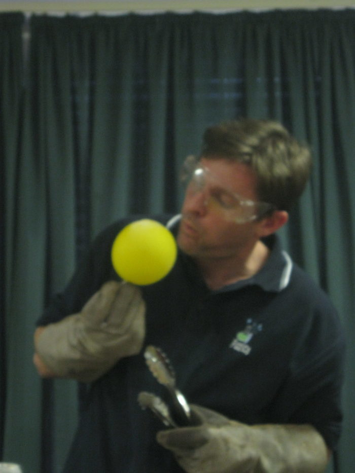 Liquid nitrogen on a balloon science experiment - blowing on a col balloon