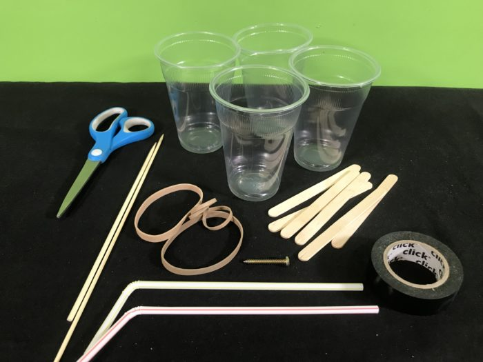 Create a rubber band racer science experiment - materials needed