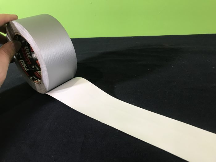 Wave demonstrator science experiment - rolling out the tape
