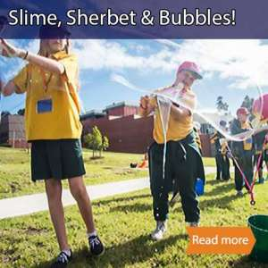 Slime sherbet bubbles school science visit tile showing students in yellow uniforms making giant bubbles