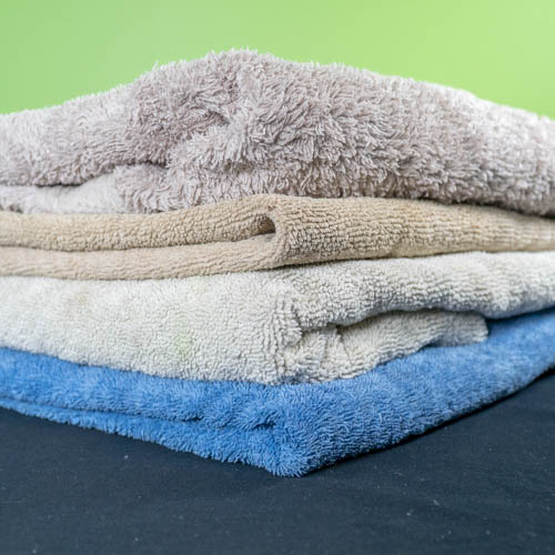 Four towels of different colours stacked on top of each other