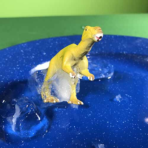 Dinosaur nearly out of the ice block