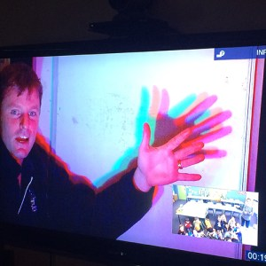 Presenter making cooured shadows on a white board during a video conference