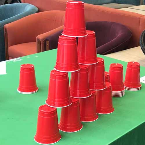 10 red cups stacking into a pyramid of 4 levels