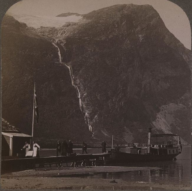 """From the southern parts of the lake Lovatn, with the tourist boat """"Lodalen"""" and the mountain Ramnefjellet in the background. Photo taken in the beginning of the 1900s."""