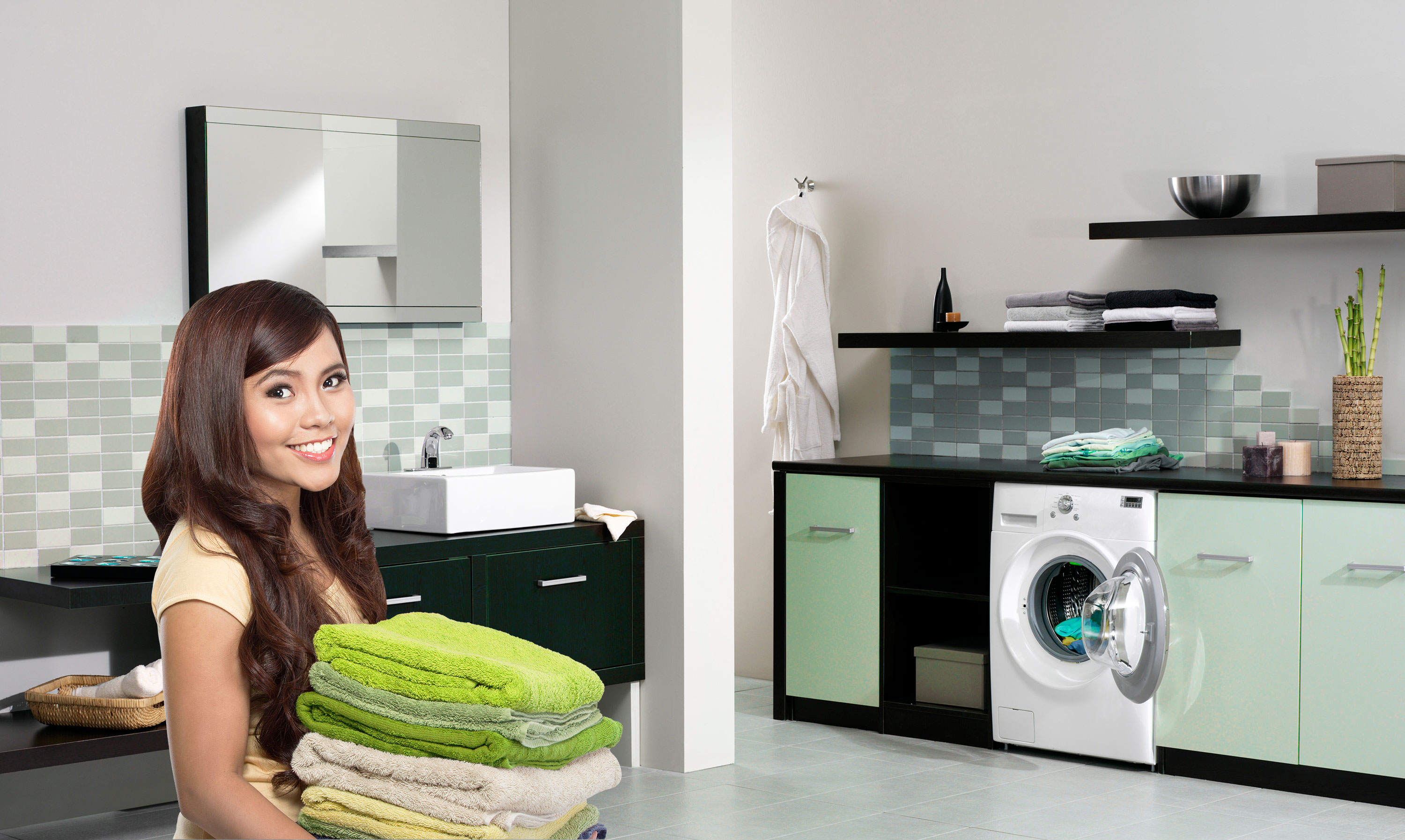woman with towels in laundry room