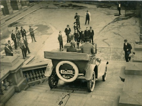 94/268/1-1/3/11 Photographic print, black and white, Overland car being driven down steps of Sydney Town Hall, No '6' verso. Milton Kent, photographer, embossed stamp to image, Sydney, New South Wales, Australia, mid 1920s (Front)