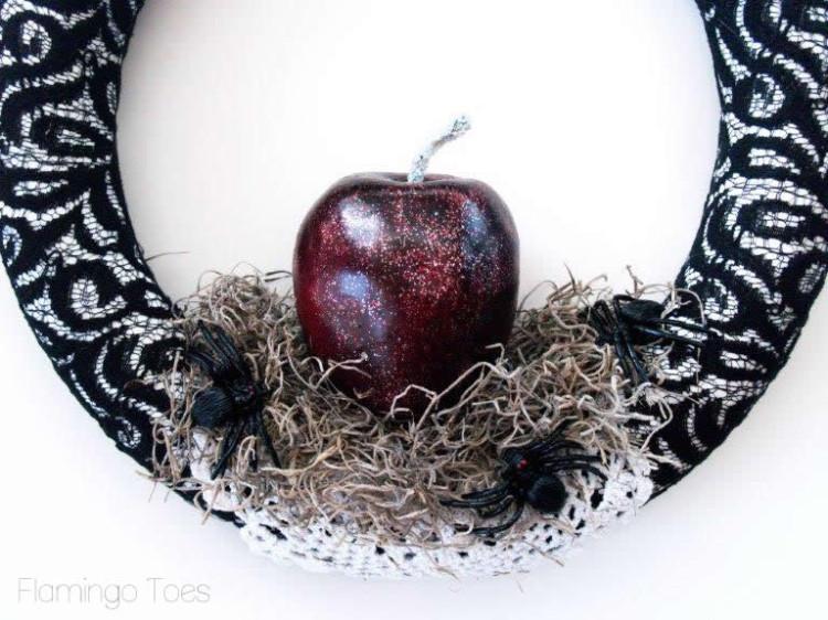 Adding apple to wreath