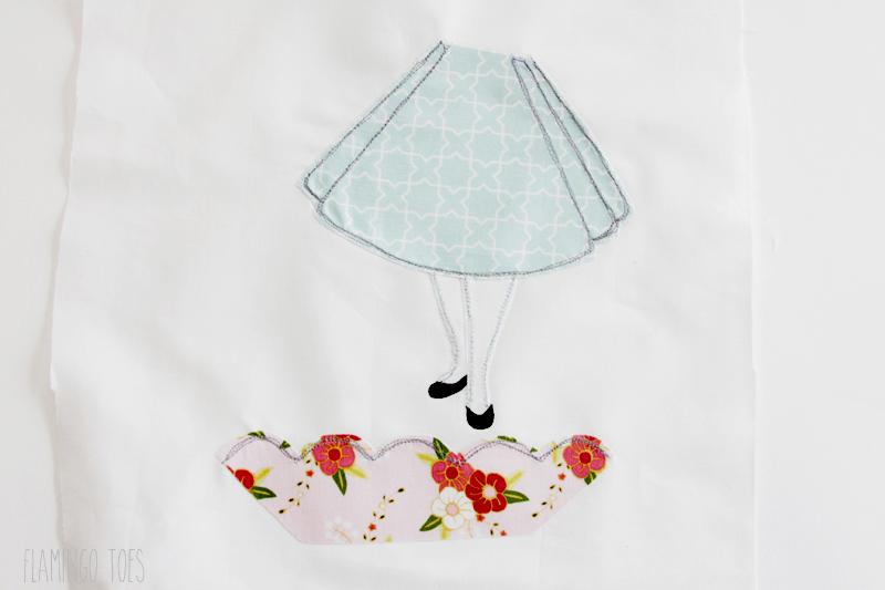 Stitching on Alice in Wonderland hoop