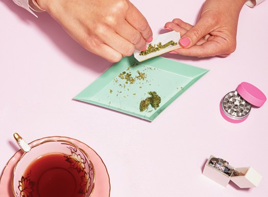 Canada's weed revolution: A photo of pink manicured hands rolling a joint.