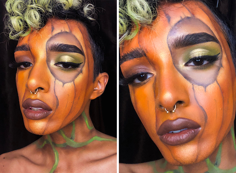 Boy with face painted as a pumpkin, with the left eye exposed to a traditional eyeshadow look, with green curly hair.