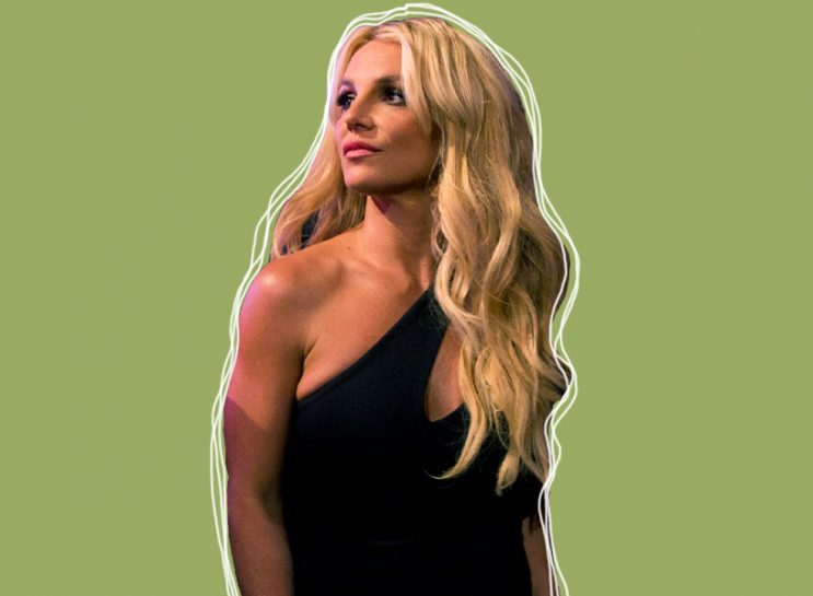 Britney Spears wearing black dress on green background