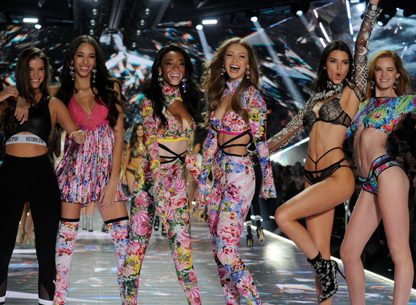 Models pose on the end of the runway at the Victoria's Secret Fashion Show