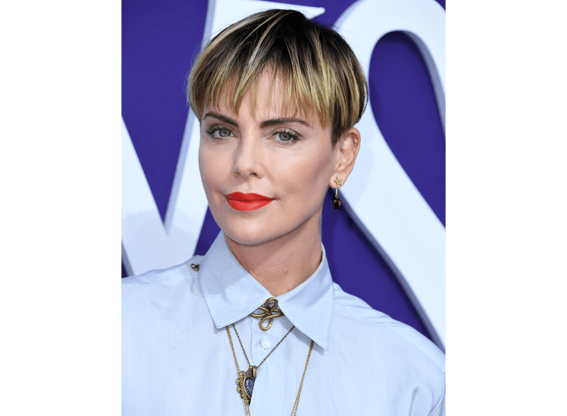 2020 hair trends: Charlize Theron with a dark bowl cut and blonde highlights.