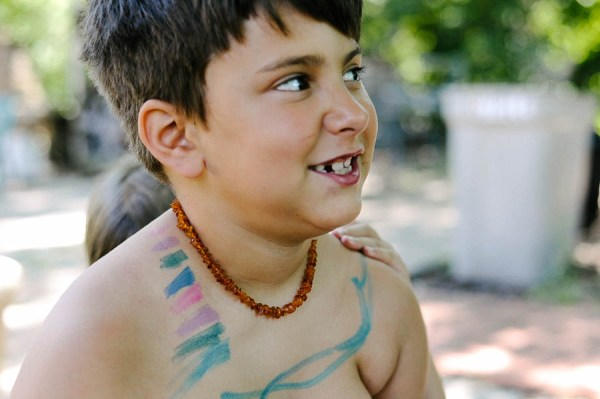 Let your kids express themselves with markers and body art.