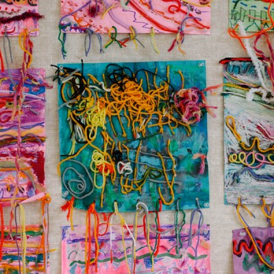 Mixed media art with kids emphasizing lines as an element of art.
