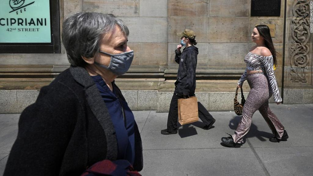 Why some vaccinated people won't go maskless -- even outdoors