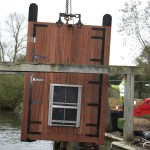 Photo of new lock gates at Flatford being craned into position - 2014