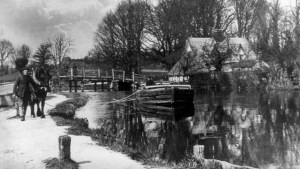 black and white photo of Lighter man and horse in front of Flatford Bridge 1905