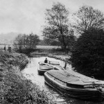 black and white photo of two lighters on the River Stour