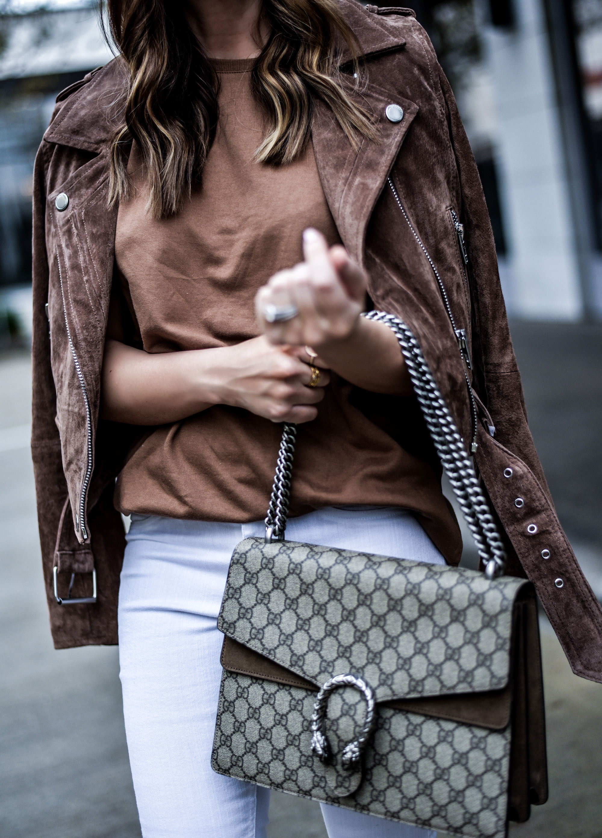 Tiffany Jais the Houston Style blogger of Flaunt and Center wearing a Blank NYC suede moto jacket with an ASOS top, white skinny jeans, and a Gucci Dionysus bag | what's trending in women's fashion