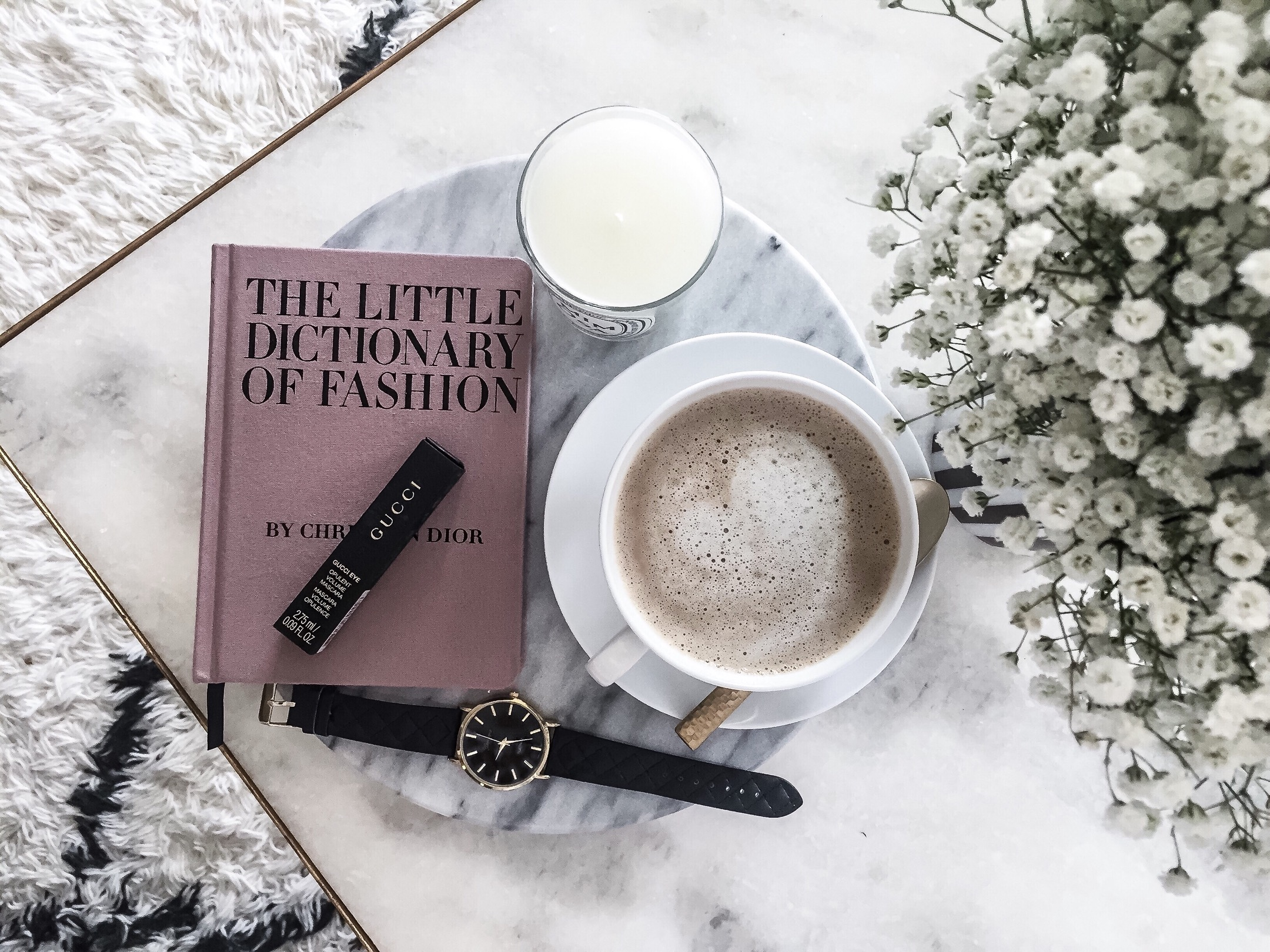 Houston style blogger Tiffany jais | The little dictionary of fashion book and a round marble serving tray