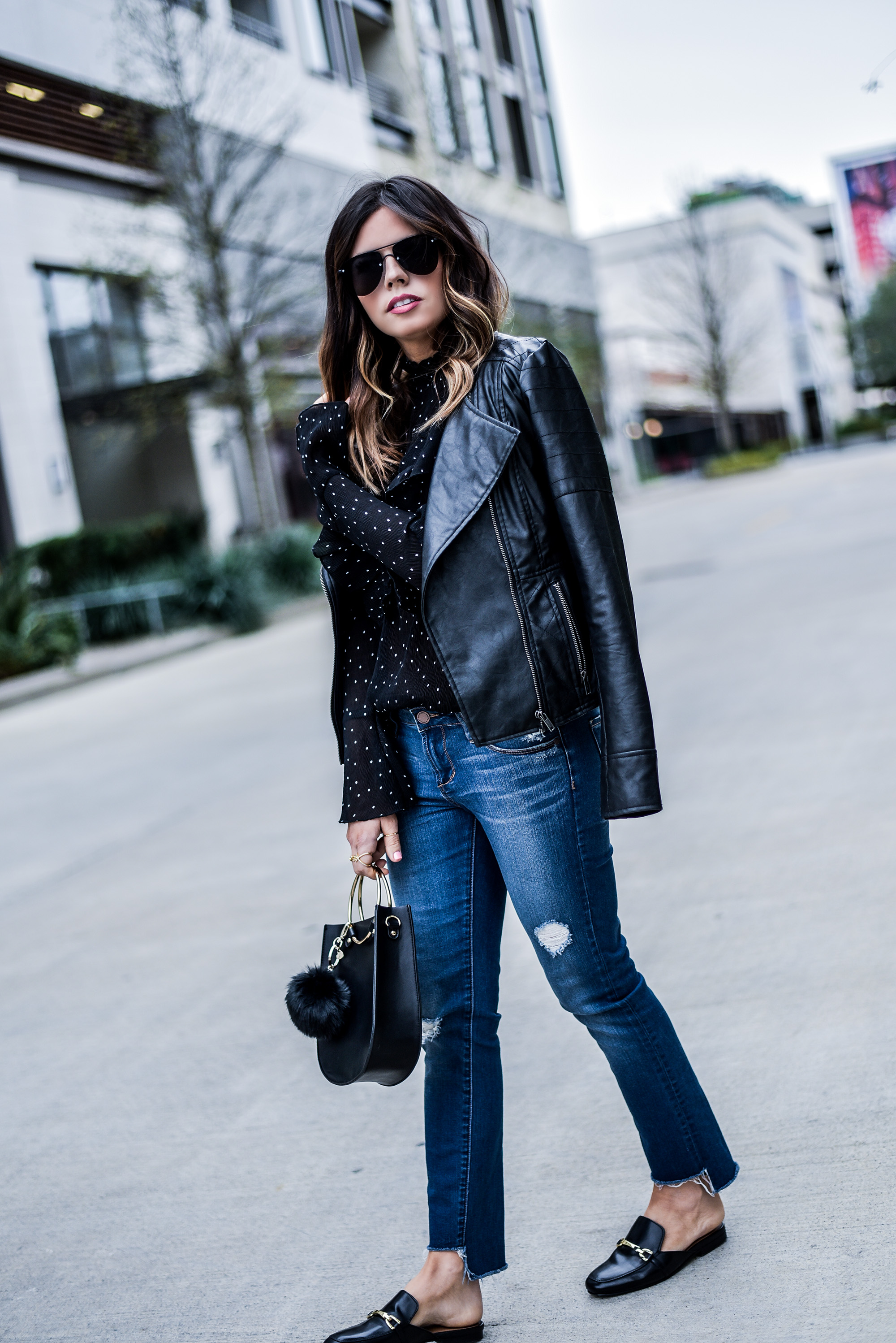 Houston fashion blogger Tiffany Jais wearing nordstrom raw hem jeans, and ASOS mules, with a leather jacket | What's trending in women's fashion
