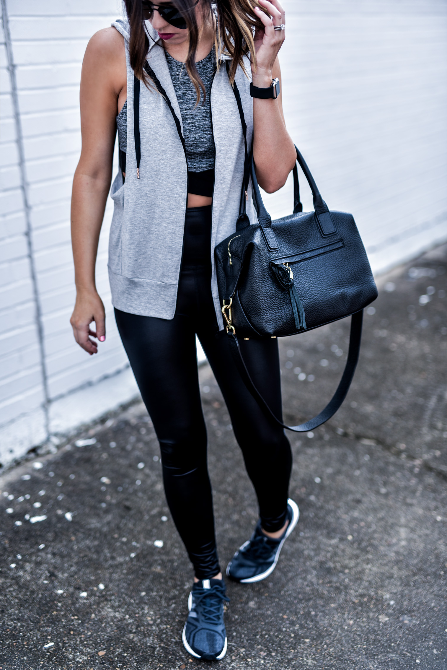 Houston fashion and lifestyle blogger Tiffany Jais wearing beyond yoga activewear, click to read more | Beyond yoga vest, high gloss leggings, beyond yoga sports bra |