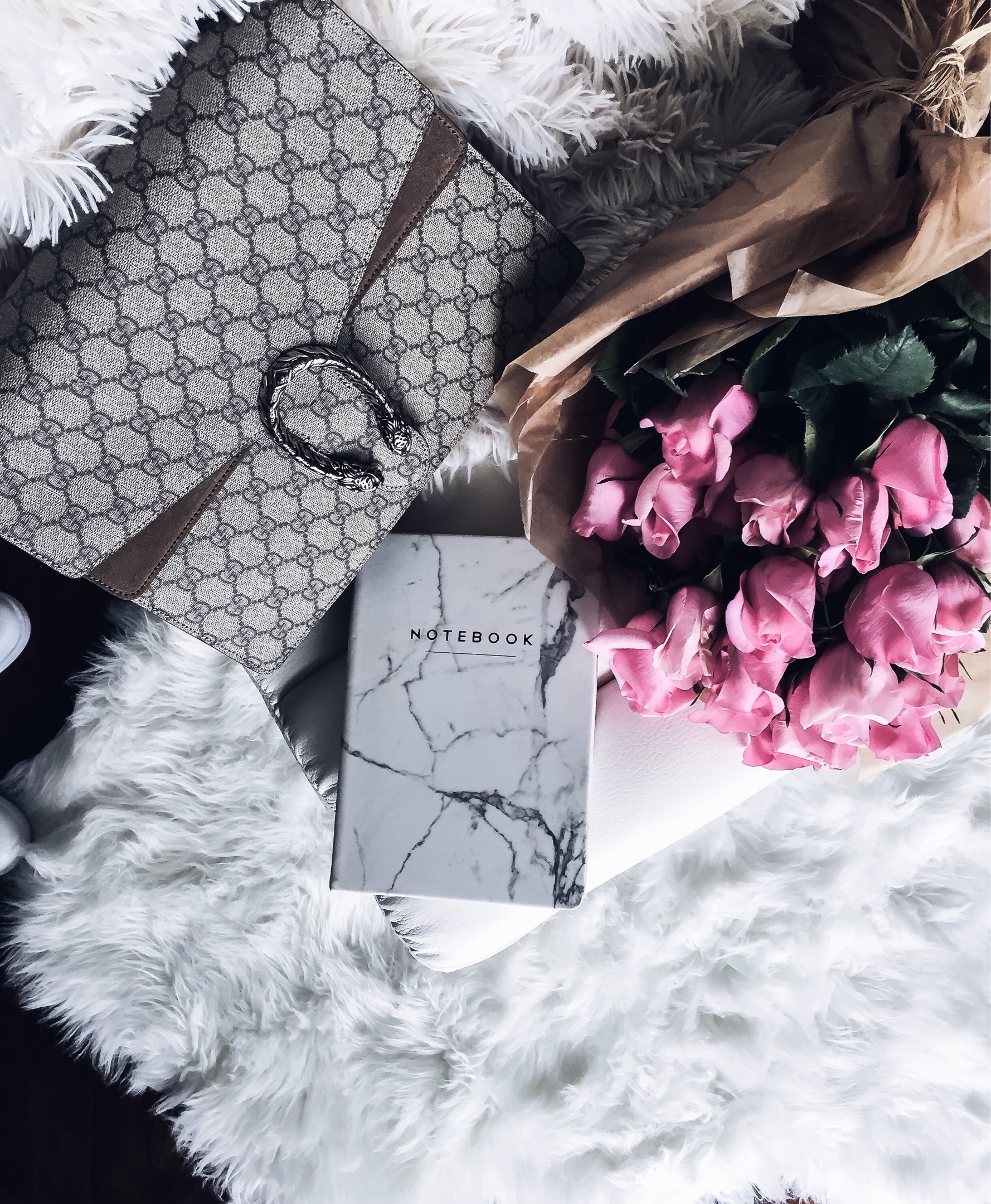 Houston fashion and lifestyle blogger Tiffany Jais of Flaunt and Center doing an instagram roundup featuring a white marble notebook and a Gucci Dionysus bag. Click here to read more! | style, what's trending in women's fashion