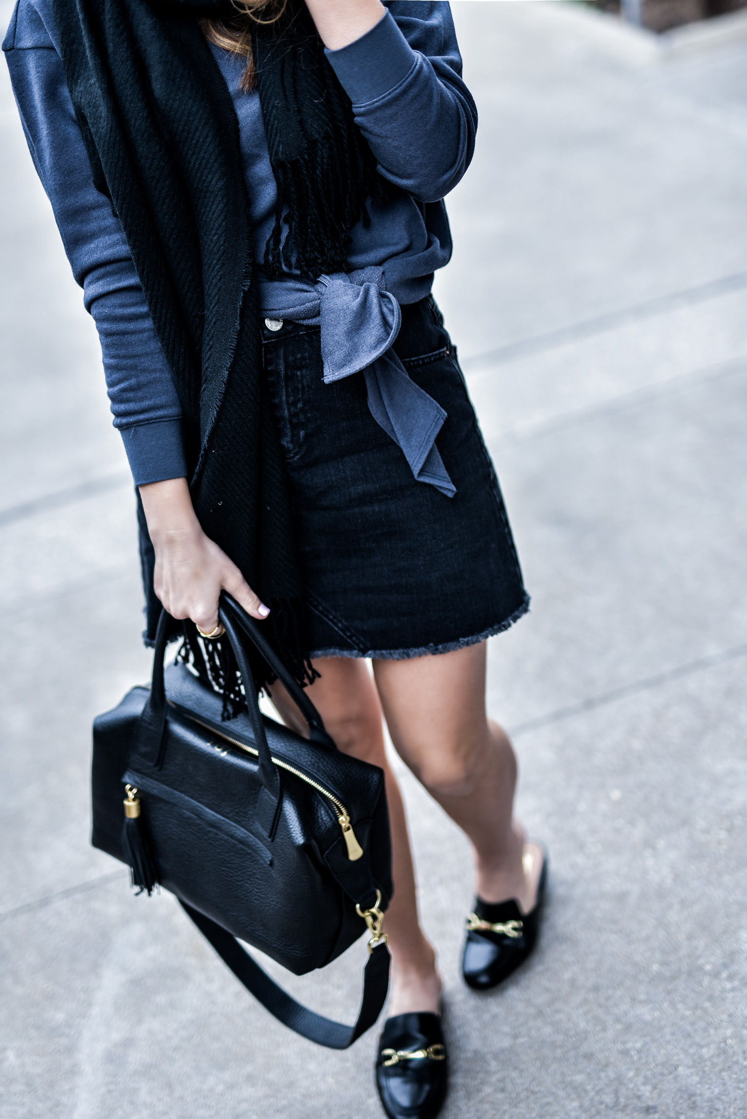 Houston fashion and lifestyle blogger wearing a denim skirt and a front tie sweater with ASOS mules | what's trending in fashion