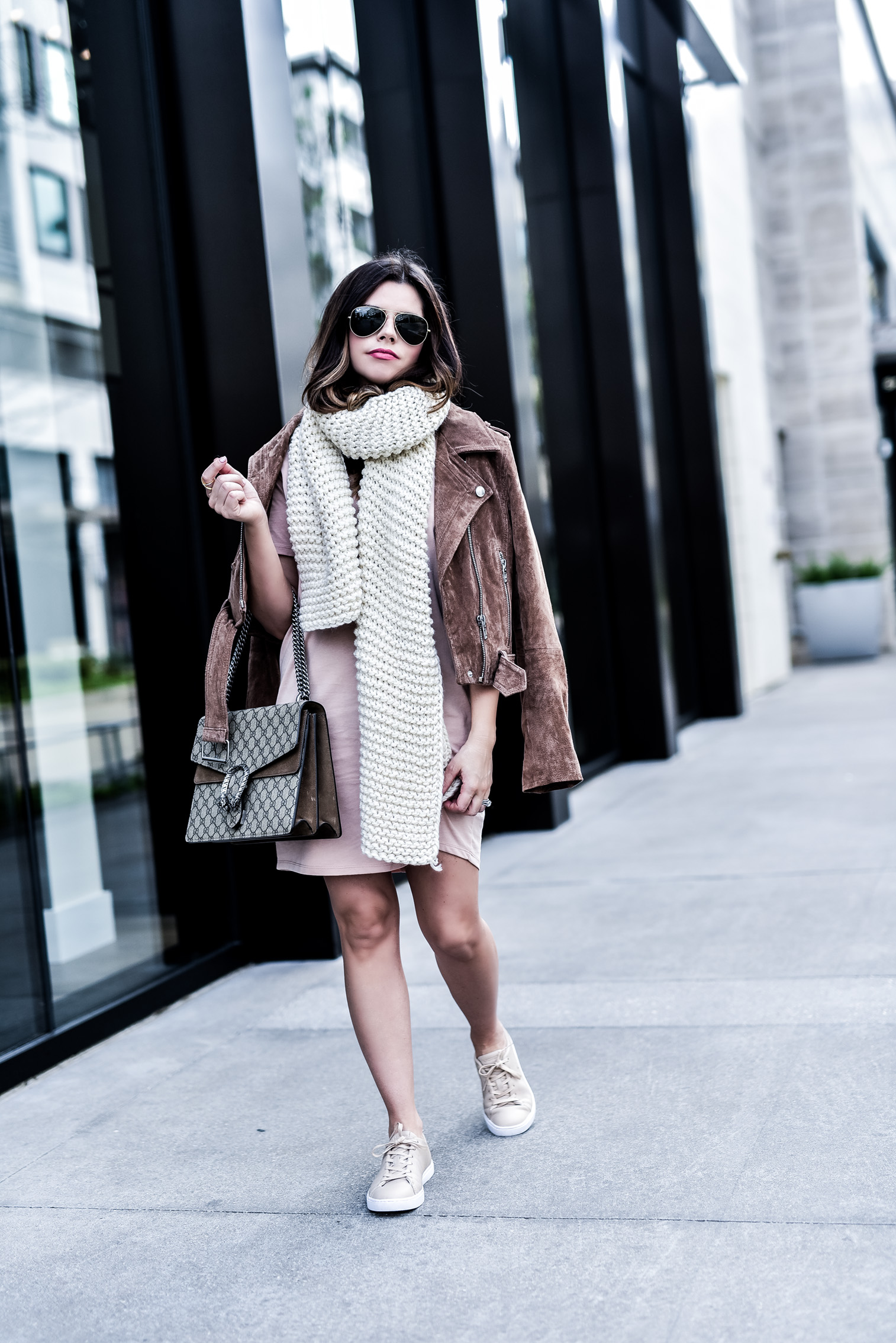 Houston fashion blogger wearing an asos pink t-shirt dress and a blank nyc suede moto jacket, read up on how to concur effortless streetstyle by clicking this photo |