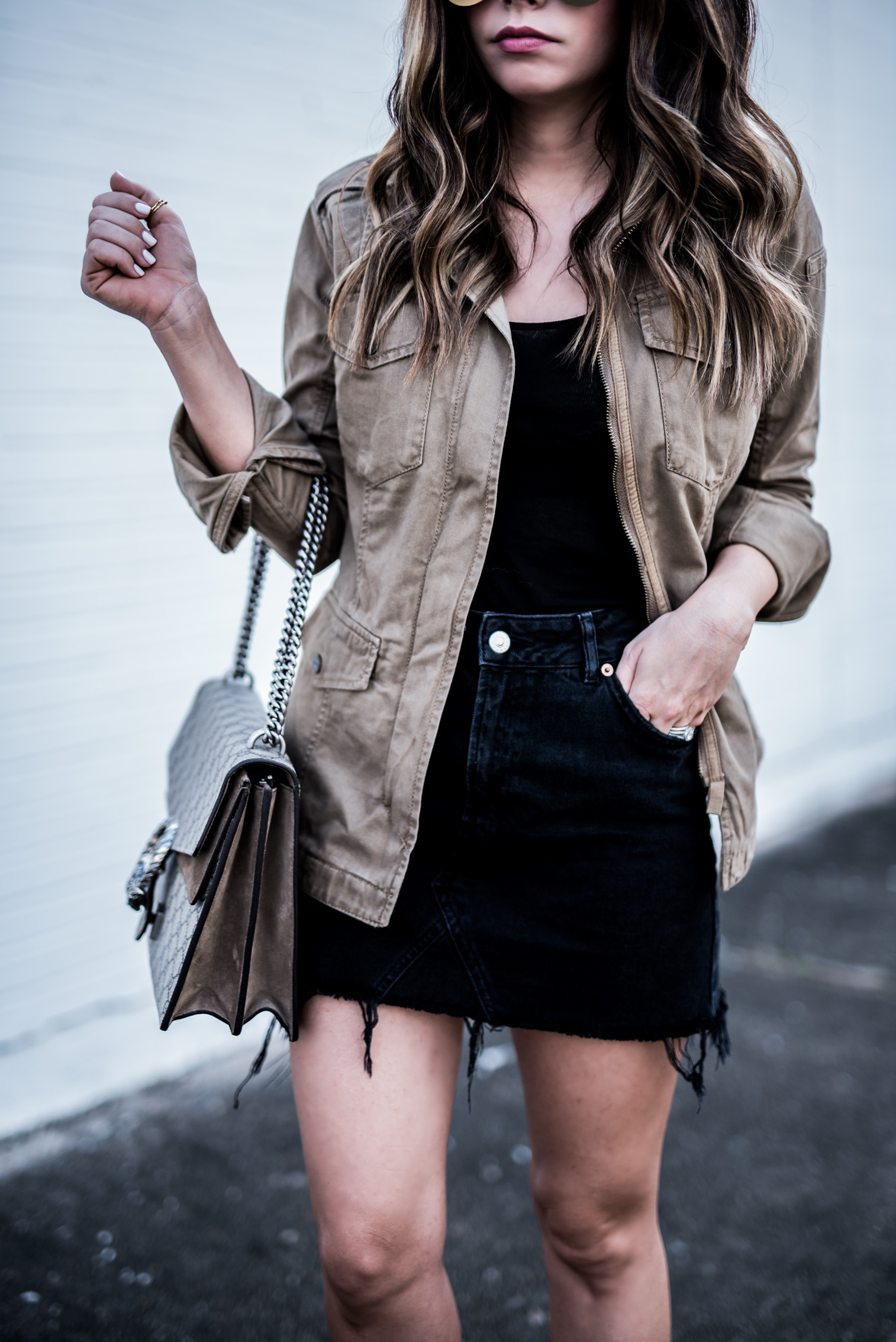 Houston fashion blogger wearing a black denim moto skirt, chloe boots, and mirrored sunglasses, click to shop the look | Outfit ideas for school, women's fashion, cute outfits for spring,