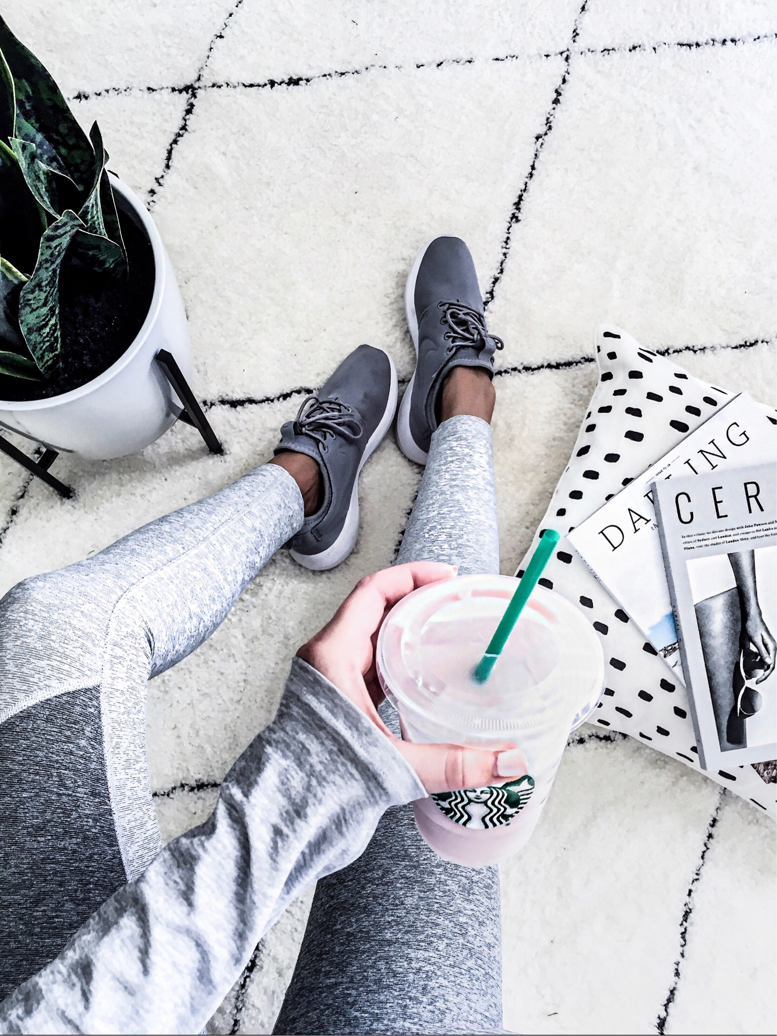 Tiffany Jais Houston fashion and lifestyle blogger of Flaunt and Center | Recent buys, Grey leggings from Outdoor Voices and grey Nikes, snake plant, mid-century planter, starbucks acai strawberry drink, black and white dotted pillow