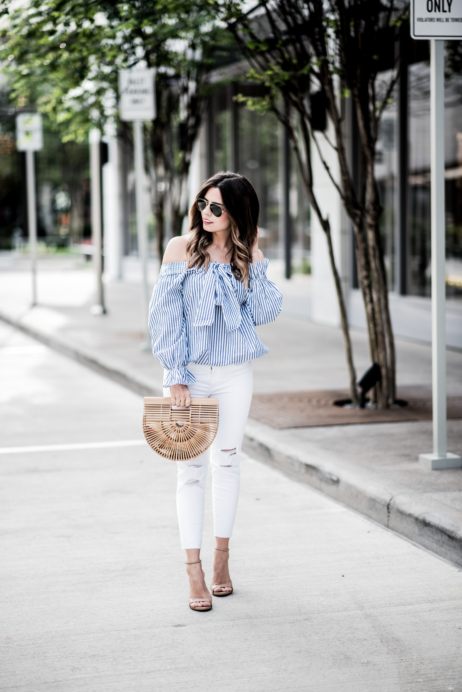 Tiffany Jais Houston fashion and lifestyle blogger | Striped off the shoulder top, white skinny jeans, small cult gaia bag, spring outfit ideas, street style fashion bloggers