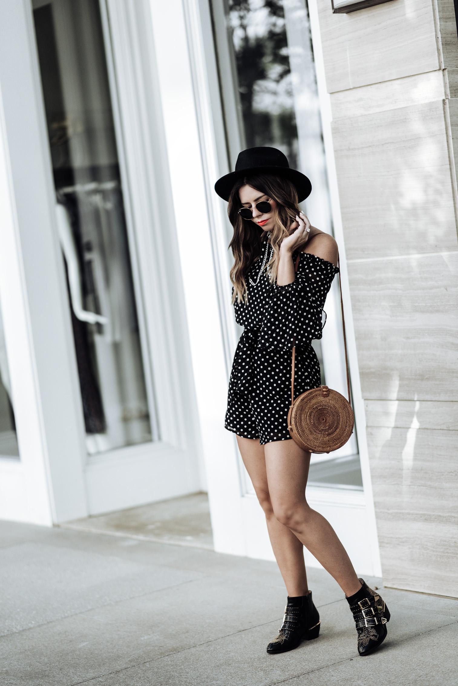 Tiffany Jais Houston fashion and lifestyle blogger | polka dot romper | round rattan bag, chloe studded boots, brixton hat