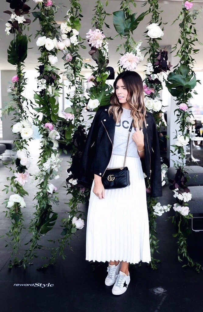Tiffany Jais fashion and lifestyle blogger of Flaunt and Center | White pleated skirt, golden goose sneakers