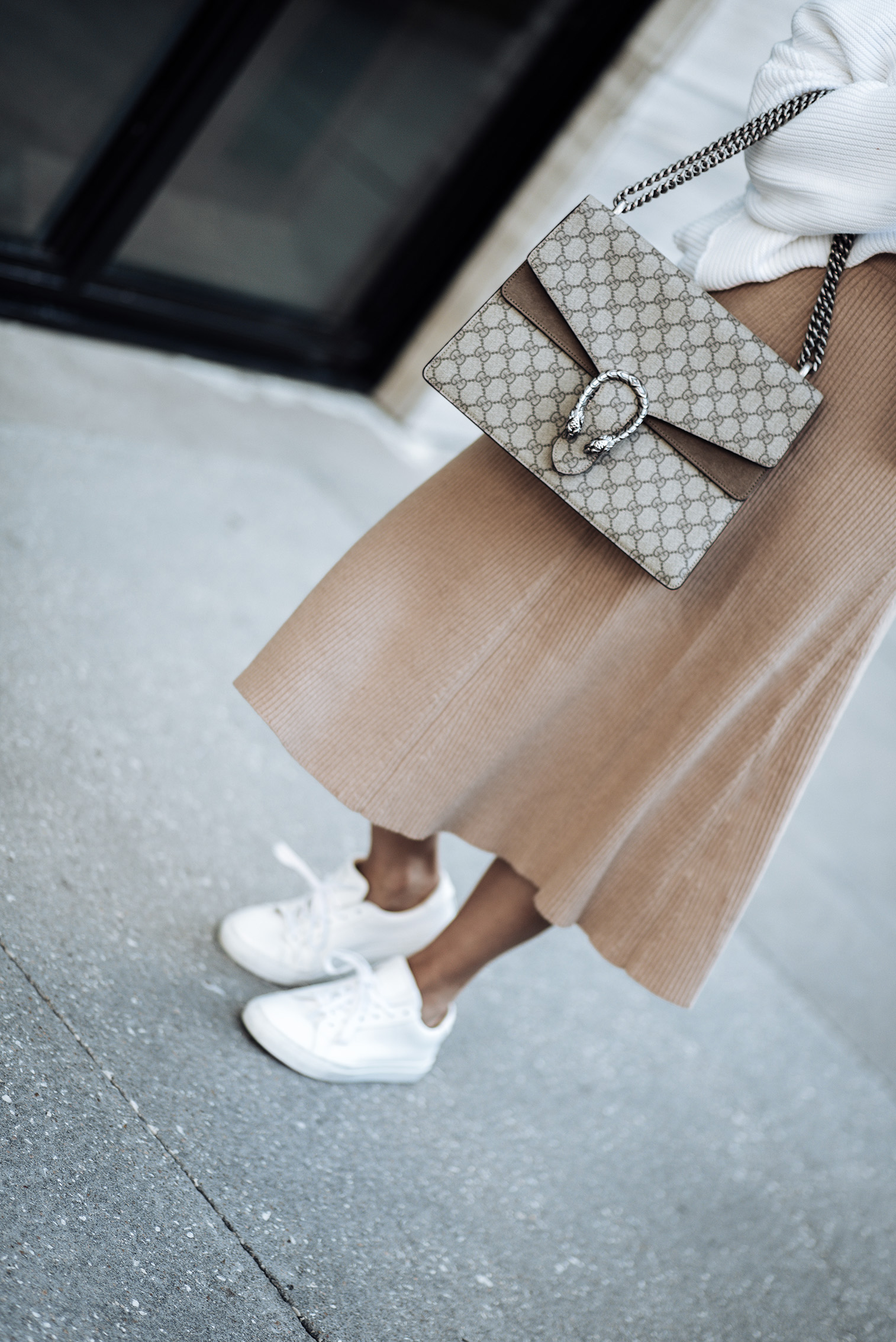 Tiffany Jais fashion and lifestyle blogger of Flaunt and Center | Houston fashion blogger | Cozy Knits | Streetstyle blog |Italian Superloft Midi Sweater Skirt | Free People La Brea Sweater | The Royal sneaker | Large Gucci Dionysus