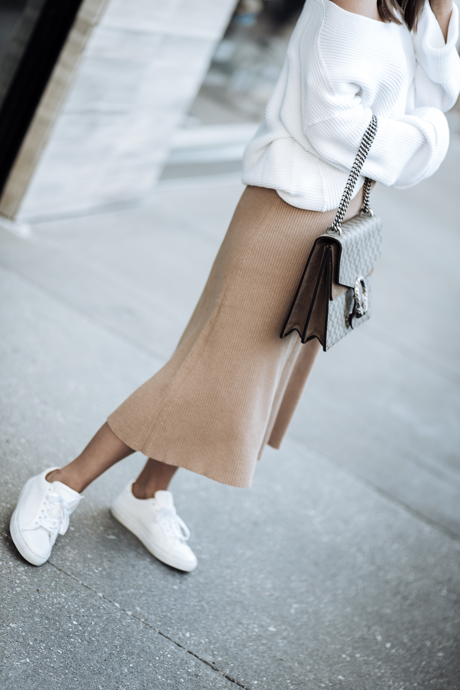 Tiffany Jais fashion and lifestyle blogger of Flaunt and Center | Houston fashion blogger | Cozy Knits | Streetstyle blog |Italian Superloft Midi Sweater Skirt | Free People La Brea Sweater | The Royal sneaker | Large Gucci Dionysus