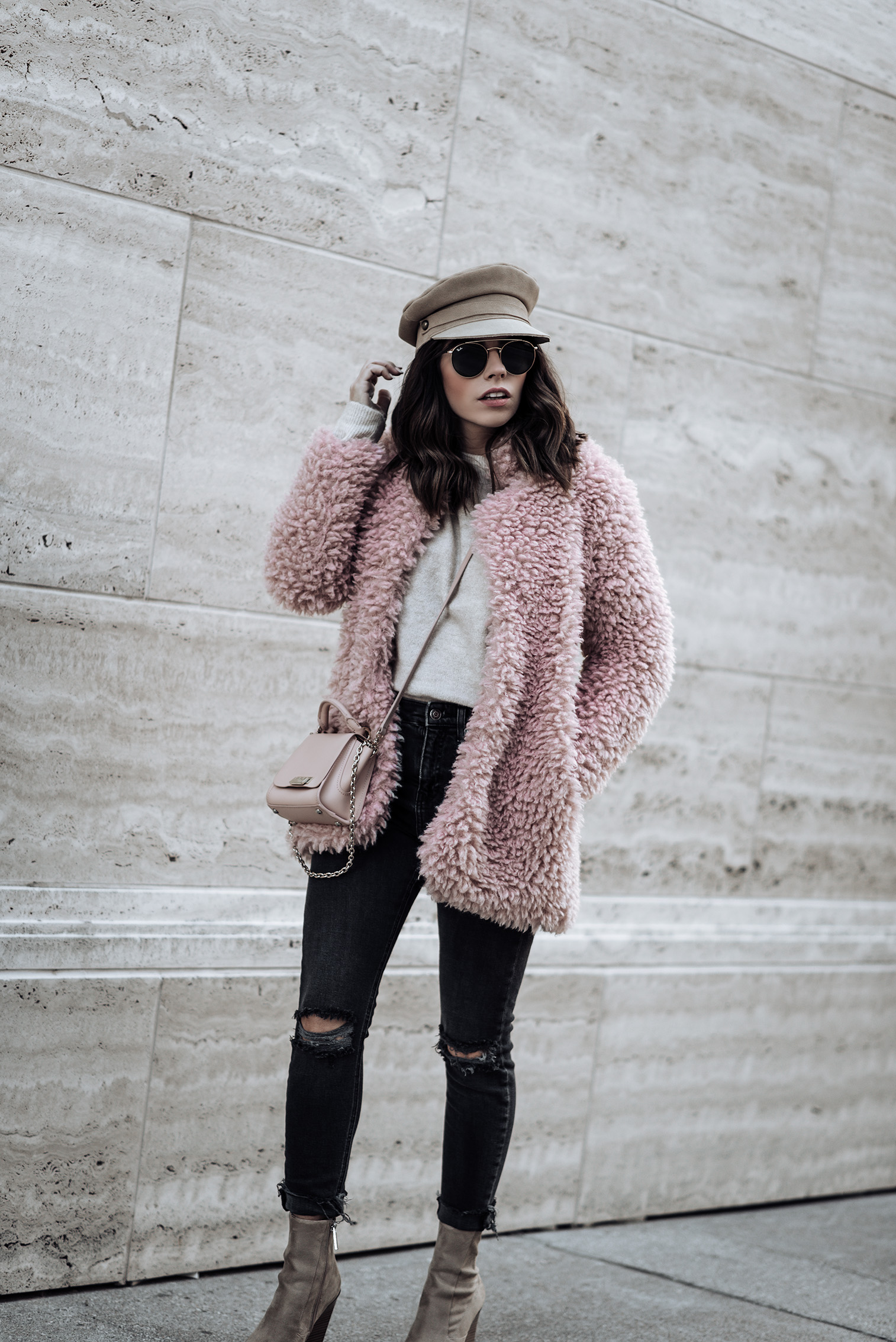 Click to shop the look: Pink Shaggy Faux Fur Coat (Amazon, also love this) | Citizens of Humanity Rocket Skinny Jeans in Distressed Dark Wash | KENDALL + KYLIE Fallyn Bootie in Camel (also similar here for less) | Lack of Color Lola Cap | 51 mm Ray-Ban Sunglasses | ASOS Nude Sweater #fauxfur #streetstyle #rippeddenim #blog #fashionblog #outfitideas