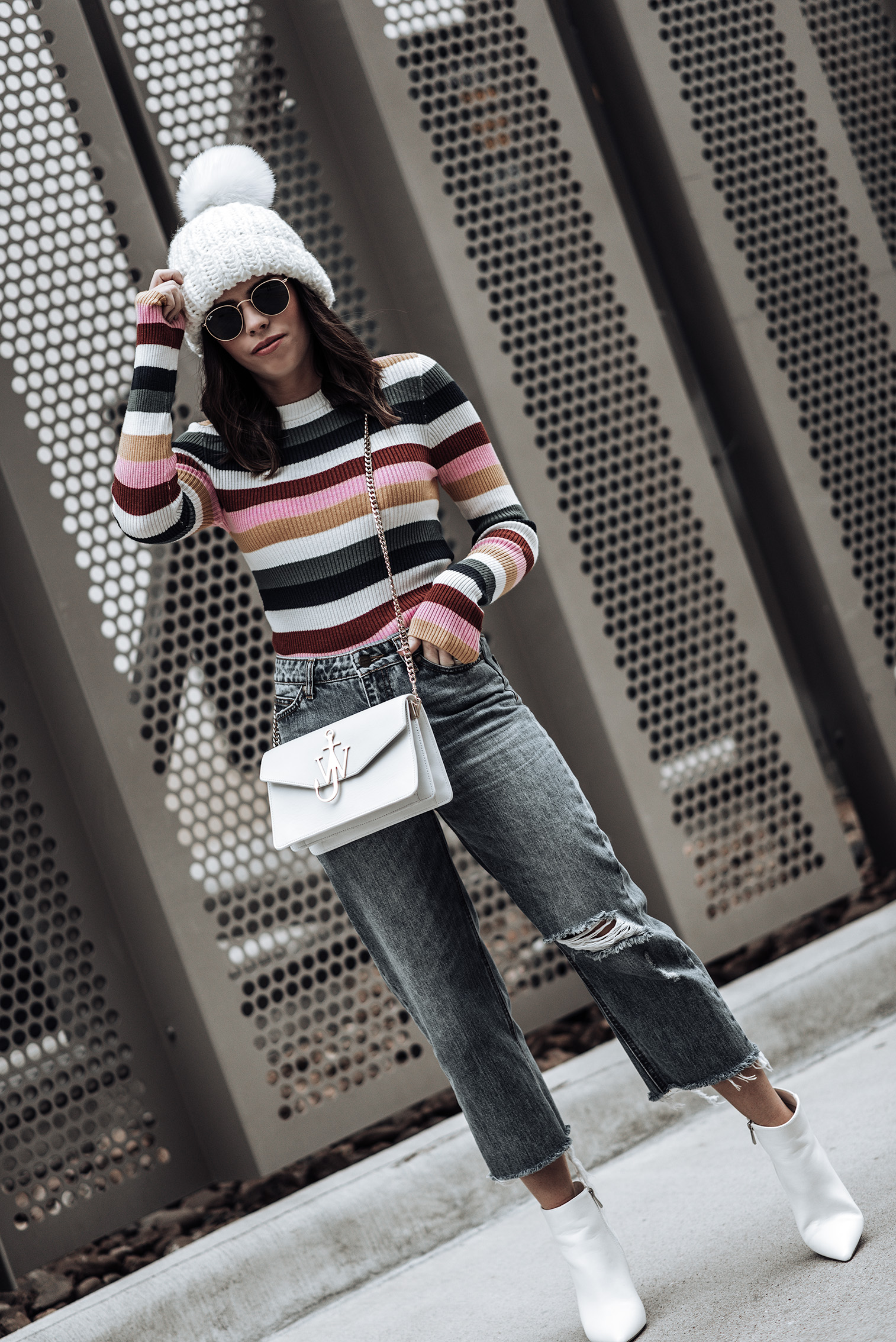 Click to shop the exact look |Bold striped sweater via Forever21 | Wide leg denim (similar style here) | J.W. Anderson bag |White ankle boots | White oversized chunky knit beanie | street style 2018 #streetstyle #jwanderson #outfitideas #beanieoutfits