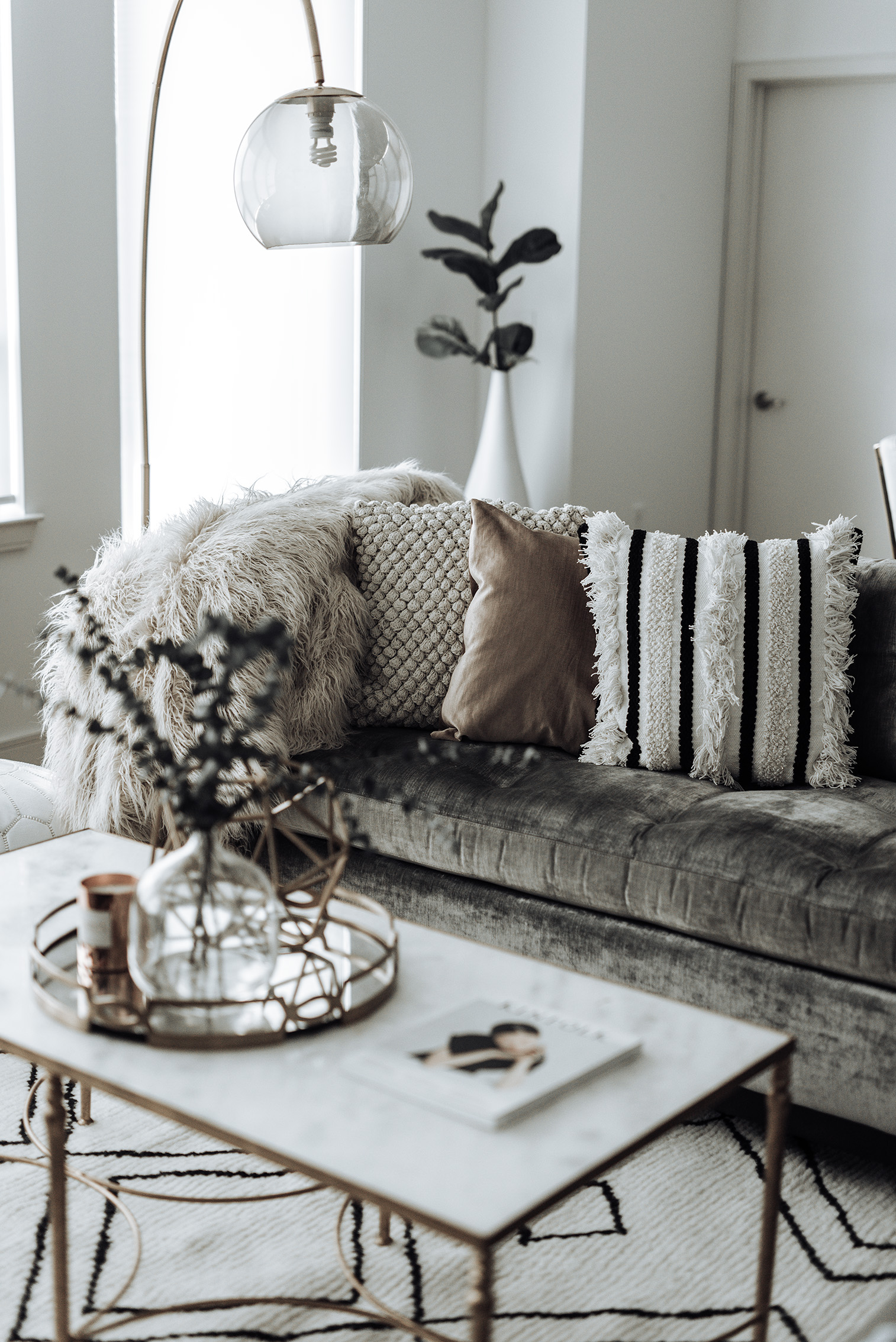 Click to shop | Family room update |Vega Moroccan Rug| Marble coffee table (similar) | White Leather Pouf Ottoman (on sale!) | Textured Indra Pillow | Glass Vase | Blush Cotton Luster Velvet Pillow | | Marisa Throw Blanket |Pompom Pillow | Overarching Lamp