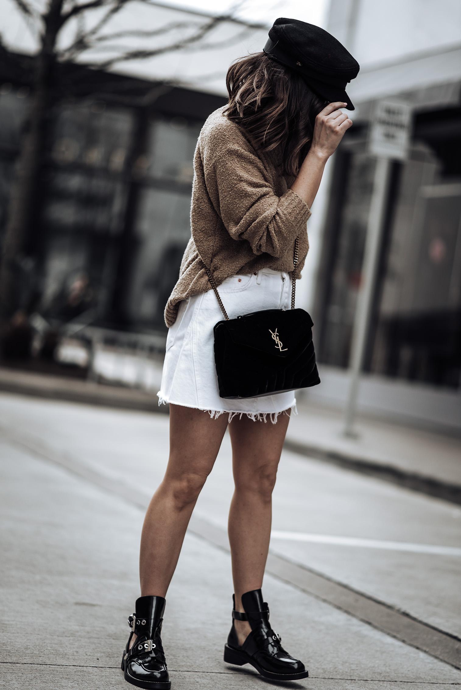 Combat boot trend | #streetstyle #blog #liketkit {C/O}GRLFRND Denim Eva A- Frame Skirt | {C/O} House of Harlow 1960 x REVOLVE Renee Pullover | Saint Laurent Small Black LouLou Velvet Bag | Bakers Cap (Similar) |Balenciaga boots Real vs.Steal)