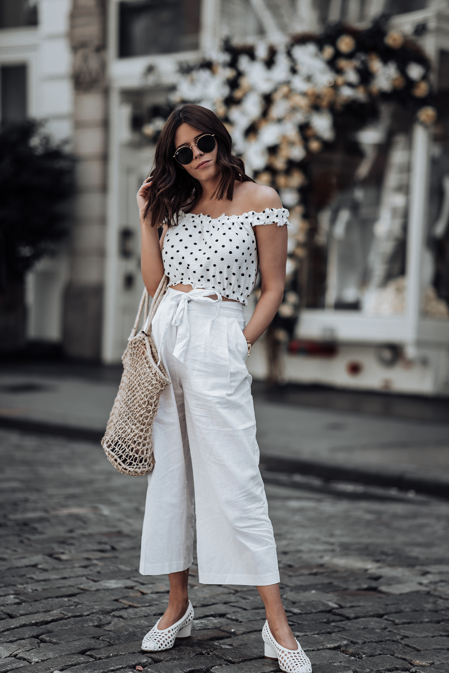 Memorial Day Sales | ASOS Tie Waist Pants (Identical here) | Topshop Polka Dot Crop Top | Topshop Woven Heels in White | Reformation Knit Market Bag (Similar) | #liketkit #paperbagpants #streetstyle #polkadots #minimalist