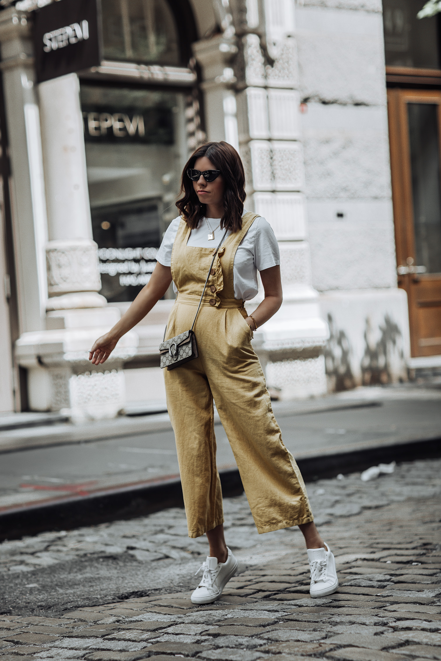 Yellow Jumpsuit (Zara, also love this) | Gucci Mini Bag | Necklaces (here, and here) | Sneakers | Monica V. Bracelets (here, & here)  #liketkit #gucci #streetstyle #zara